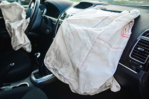 view of driver and passenger deployed airbags